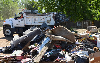 Park technician Jimmy Ripley backs up a dumptruck full of trash to unload as community members clean the neighborhood Saturday, April 30, 2016, at Myers Street and Wyandotte Avenue in south Oroville, California. (Dan Reidel -- Enterprise-Record)