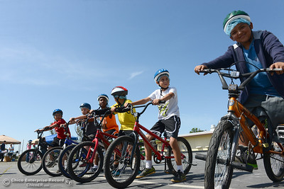 """Ezekiel Vera, 11, right, and other kids prepare to go through the """"slow ride"""" challenge of Oakdale Heights School's bike rodeo Friday, April 29, 2016, at the school to teach kids to ride bicycles safely in Oroville, California. Event organizer Ann Dickman said 17 bicycles were donated and children shared their bikes to get about 225 kids through the bike rodeo. (Dan Reidel -- Mercury-Register)"""
