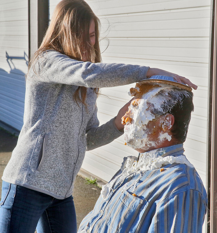 . Shaun Walker � The Times-Standard  Board secretary Emily Abfalter takes her turn as McKinleyville Community Services District General Manager, Greg Orsini gets one of 11 pies in his face to raise money for Toys for Tots on Friday. Employees of MCSD paid $20 each for an opportunity to toss a pie in their boss�s face. All proceeds of the event will go to Toys for Tots. The �sweetie pie� GM challenged other local managers and executives to take one in the face to help support their favorite charity during this holiday season.