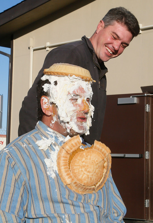 . Shaun Walker � The Times-Standard  McKinleyville Community Services District General Manager Greg Orsini reacts after utility worker Kyle Stone shoved one of 11 pies in his face on Friday. Employees of MCSD paid $20 each for an opportunity to toss a pie in their boss�s face. All proceeds of the event will go to Toys for Tots. The �sweetie pie� GM challenged other local managers and executives to take one in the face to help support their favorite charity during this holiday season.