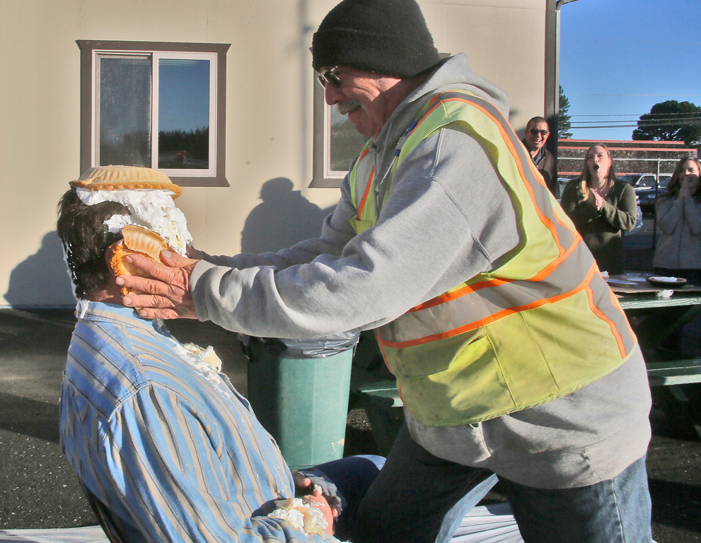 . Shaun Walker � The Times-Standard  McKinleyville Community Services District General Manager, Greg Orsini gets one of 11 pies squeezed onto his ears by seasonal laborer Paul Michael Roberts on Friday. Employees of MCSD paid $20 each for an opportunity to toss a pie in their boss�s face. All proceeds of the event will go to Toys for Tots. The �sweetie pie� GM challenged other local managers and executives to take one in the face to help support their favorite charity during this holiday season.