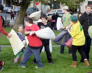 Shaun Walker — The Times-Standard  Participants battle it out during a flash-mob-style friendly pillow fight on the Arcata Plaza late Tuesday afternoon. The event, with about 40 people and primarily organized through Facebook, was partly modeled after an annual Valentine's Day public pillow fight in downtown San Francisco.