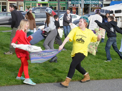 Shaun Walker — The Times-Standard  Saule Bright, 9, of McKinleyville, left, and event organizer Rilo DeAna of Arcata battle it out during a flash-mob-style friendly pillow fight on the Arcata Plaza late Tuesday afternoon. The event, with about 40 people and primarily organized through Facebook, was partly modeled after a big annual Valentine's Day public pillow fight in downtown San Francisco.