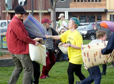 Shaun Walker — The Times-Standard  Event organizer Rilo DeAna of Arcata battle it out during a flash-mob-style friendly pillow fight on the Arcata Plaza late Tuesday afternoon. The event, with about 40 people and primarily organized through Facebook, was partly modeled after a big annual Valentine's Day public pillow fight in downtown San Francisco.