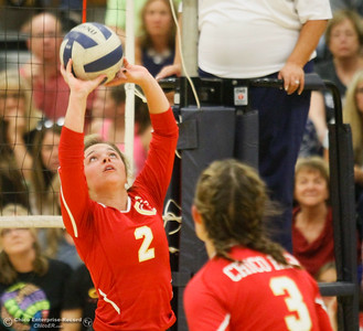 Chico High's Hannah Fortier sets the ball during the second set of a volleyball game against Pleasant Valley Thursday October 6, 2016 at Pleasant Valley in Chico, California. After Panthers took the first set 25-10 the Vikings where on high alert.(Emily Bertolino -- Enterprise-Record)