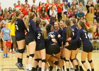 Pleasant Valley's volleyball team celebrates after a 3-1 win over Chico High Thursday October 6, 2016 at Pleasant Valley in Chico, California. (Emily Bertolino -- Enterprise-Record)
