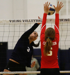 Pleasant Valley's Sirena Tuitele spikes the ball as Chico defender Myriah Logan reaches up for the block during a volleyball game Thursday October 6, 2016 at Pleasant Valley in Chico, California. (Emily Bertolino -- Enterprise-Record)