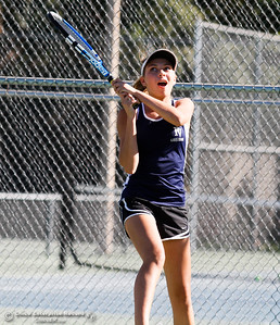 Pleasant Valley's Nicole Flint follows through on her swing during a tennis match against Chico High's Kaitlin Robertson September 21, 2016 at the 20th Street Park in Chico, Calif. (Emily Bertolino -- Enterprise-Record)