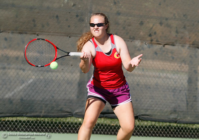 Chico High's Kaitlin Robertson returns Pleasant Valley's Nicole Flint's serve during a tennis match September 21, 2016 at the 20th Street Park in Chico, Calif. Robertson won the number one match but Pleasant Valley the overall match. (Emily Bertolino -- Enterprise-Record)