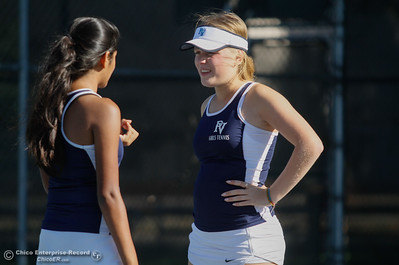 During a three hour match doubles teammakes Anna Broadesser and Krishna Patel talk strategy as they battle with Chico's Lienna Chan and Olivia Zepeda September 21, 2016 at the 20th Street Park in Chico, Calif. (Emily Bertolino -- Enterprise-Record)