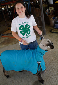 Pehton Hubbard poses with her sheep Big-E as work continues in preparation for the Silver Dollar Fair Wednesday May 24, 2017 at the Silver Dollar Fairgrounds in Chico, California. (Emily Bertolino -- Enterprise-Record)