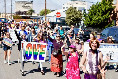 Participants wave to friends and neighbors cheering on the Redwood Pride parade.  (Jose Quezada — For the Times-Standard)