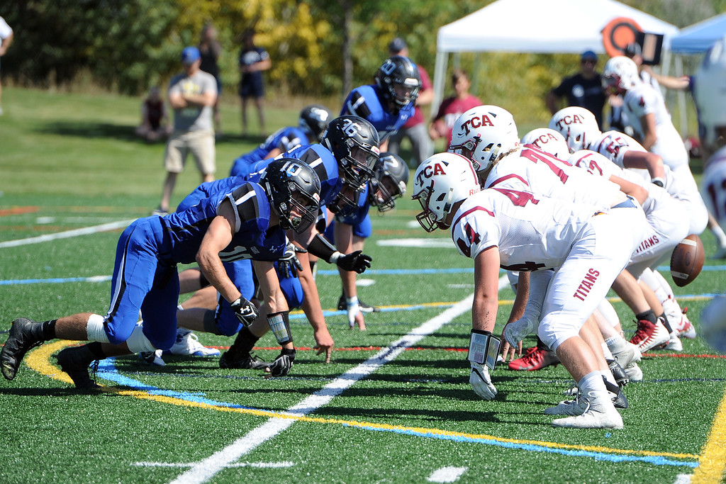 . The Resurrection Christian defensive line fires off the line of scrimmage during a game against The Classical Academy on Saturday, Sept. 15, 2018 at Loveland Sports Park. (Sean Star/Loveland Reporter-Herald)