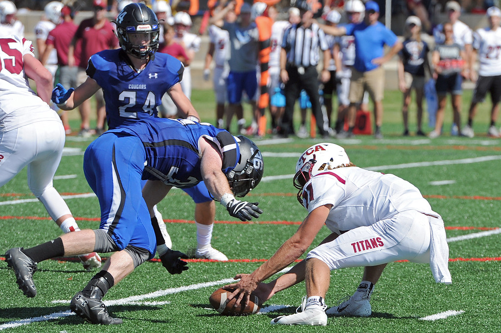 . Resurrection Christian\'s Evan King rushes punter Ethan Boyles during a game against The Classical Academy on Saturday, Sept. 15, 2018 at Loveland Sports Park. (Sean Star/Loveland Reporter-Herald)