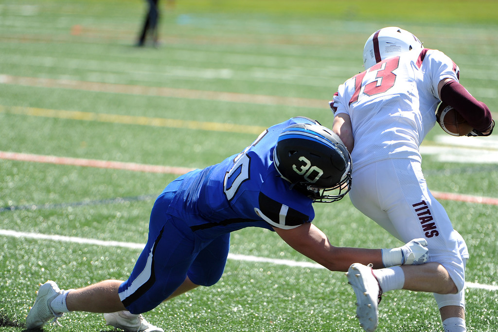 . Resurrection Christian\'s Kyle Lueck (30) tackles The Classical Academy\'s Aden Timson during a game against on Saturday, Sept. 15, 2018 at Loveland Sports Park. (Sean Star/Loveland Reporter-Herald)