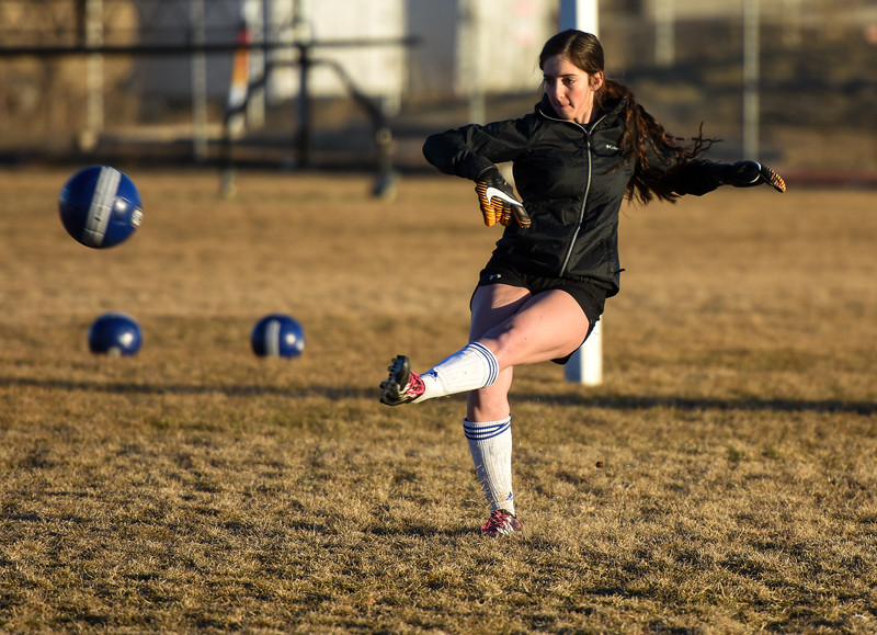 Resurrection Christian goalkeeper Faith Brown boots a ball downfield during practice Tuesday March 6, 2018 at RCS. (Cris Tiller / Loveland Reporter-Herald)