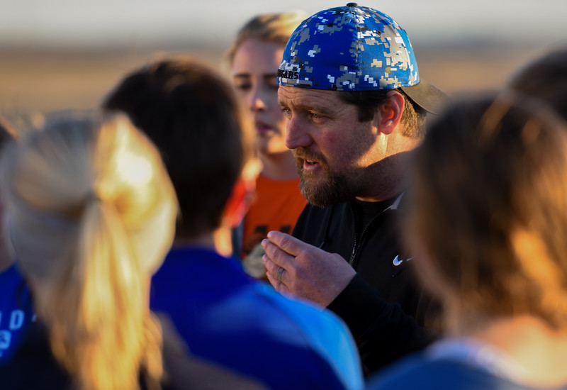 Resurrection Christian girls soccer coach Randy Wolf instructs his players during practice Tuesday March 6, 2018 at RCS. (Cris Tiller / Loveland Reporter-Herald)