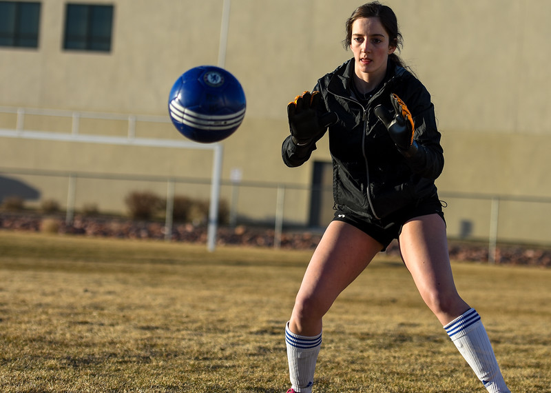 Resurrection Christian goalkeeper Faith Brown works on her ball handling during practice Tuesday March 6, 2018 at RCS. (Cris Tiller / Loveland Reporter-Herald)