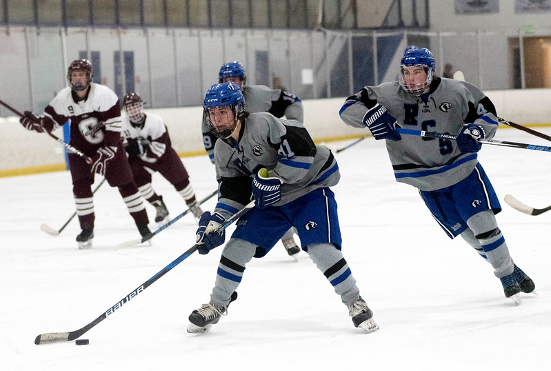 Resurrection Christian's Keenan Forkner skates his way to a hat trick during the second period of Saturday's game at NoCo Ice Center in Fort Collins. (Chris Stark / For the Reporter-Herald)