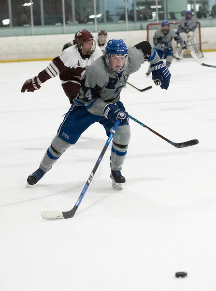 Kolby Donovan of Resurrection Christian chases the puck during the first period of Saturday's game agains Cheyenne Mountain High School at NoCo Ice Center in Fort Collins. (Chris Stark / For the Reporter-Herald)