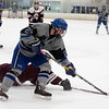 Michael Lewis of Resurrection Christian fights TJ Farrell of Cheyenne Mountain High School for the puck during the first period of Saturday's game at NoCo Ice Center in Fort Collins. (Chris Stark / For the Reporter-Herald)