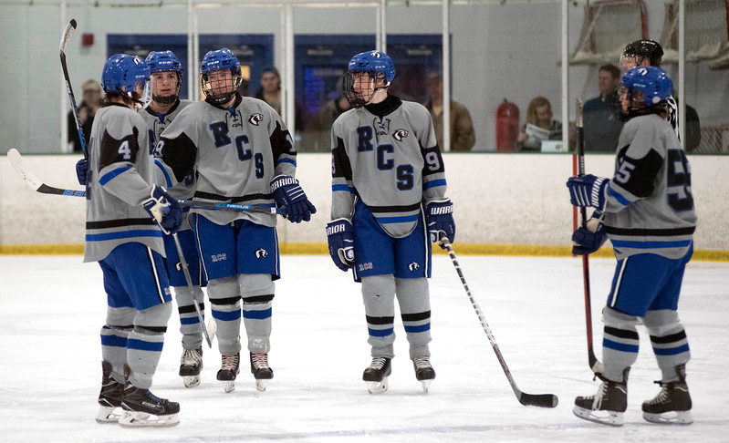 From left, Kolby Donovan, Keenan Forkner, Brennan McFarland, Treycen Eckman and Eric Tyrell of Resurrection Christian celebrate a second-period goal during Saturday's game against Cheyenne Mountain High School at NoCo Ice Center in Fort Collins. (Chris Stark / For the Reporter-Herald)