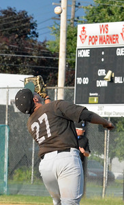 KYLE MENNIG - ONEIDA DAILY DISPATCH Sherrill Silversmith Michael Palos reaches to make a catch and retire a Rome Generals batter during their game in Sherrill on Saturday, July 23, 2016.