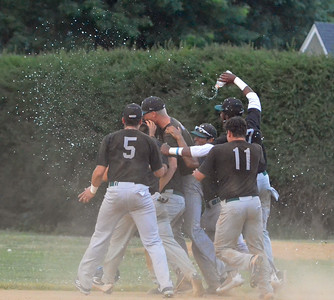 KYLE MENNIG - ONEIDA DAILY DISPATCH The Sherrill Silversmiths celebrate their walk-off victory over the Rome Generals in Sherrill on Saturday, July 23, 2016.