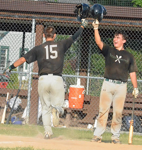 KYLE MENNIG - ONEIDA DAILY DISPATCH Sherrill Silversmiths Phillip Jasak (15) and Joe McMahon (11) celebrate after Jasak's home run against the Rome Generals in Sherrill on Saturday, July 23, 2016.