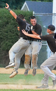 KYLE MENNIG - ONEIDA DAILY DISPATCH Sherrill Silversmiths Phillip Jasak (15) and Nate Rossi (25) celebrate after Rossi's single gave them a walk-off victory over the Rome Generals in Sherrill on Saturday, July 23, 2016.