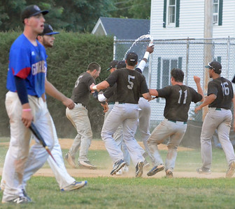 KYLE MENNIG - ONEIDA DAILY DISPATCH The Sherrill Silversmiths celebrate their walk-off victory as the Rome Generals leave the field with a piece of Nate Rossi's bat in Sherrill on Saturday, July 23, 2016. Rossi had the game-winning single in the bottom of the ninth inning.