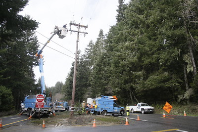 Shaun Walker — The Times-Standard  Pacific Gas and Electric crews work to restore electricity service near the corner of Stagecoach Road and Patrick's Point Road on Tuesday afternoon. Part of a tree fell across power lines, affecting power for residents of Patrick's Point Road. The outage and two other Trinidad area ones were expected to all be restored by midnight Tuesday after as many as 559 customers lost power.