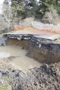Shaun Walker — The Times-Standard  Eel River Drive was closed a bit south of Loleta on Tuesday afternoon.