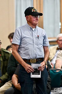 One of a few Korean War veterans stands to be recognized.