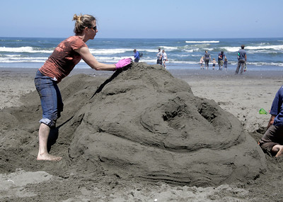 Shaun Walker — The Times-Standard  Kristen Thomas works on a dragon named Falkor the Friends of the Dunes Sand Sculpture Festival in Manila on Saturday