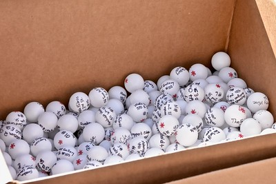 "Ping-pong balls inscribed with names of a Eureka business and corresponding prize/discount at the ready for launching as ""snowballs."" José Quezada—For Times-Standard"