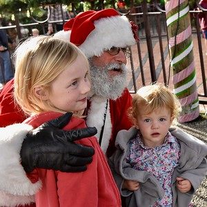 Sonja Ondera, 5, and sister Lena Onders, 21 months, sit with Santa Claus. José Quezada—For Times-Standard