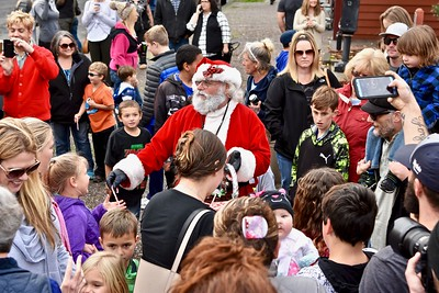 Santa Claus caught spreading cheer and sweetness in Old Town, Eureka. José Quezada—For Times-Standard