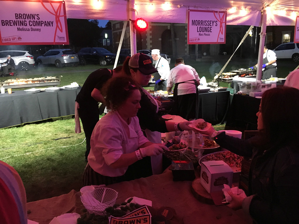 . MARK ROBARGE - MROBARGE@DIGITALFIRSTMEDIA.COM Chef Melissa Doney of Brown\'s Brewing Company dishes up some barbecued treats during the Fired Up! Grill Competition held Friday night as part of the annual Saratoga Wine and Food Festival on the grounds of the Saratoga Performing Arts Center.