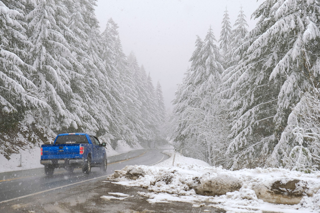 . Shaun Walker � The Times-Standard  A truck heads toward Willow Creek a few miles east of Berry Summit on Highway 299 on Friday afternoon. Substantial snow was still predicted through roughly 10 a.m. Sunday near the summit.