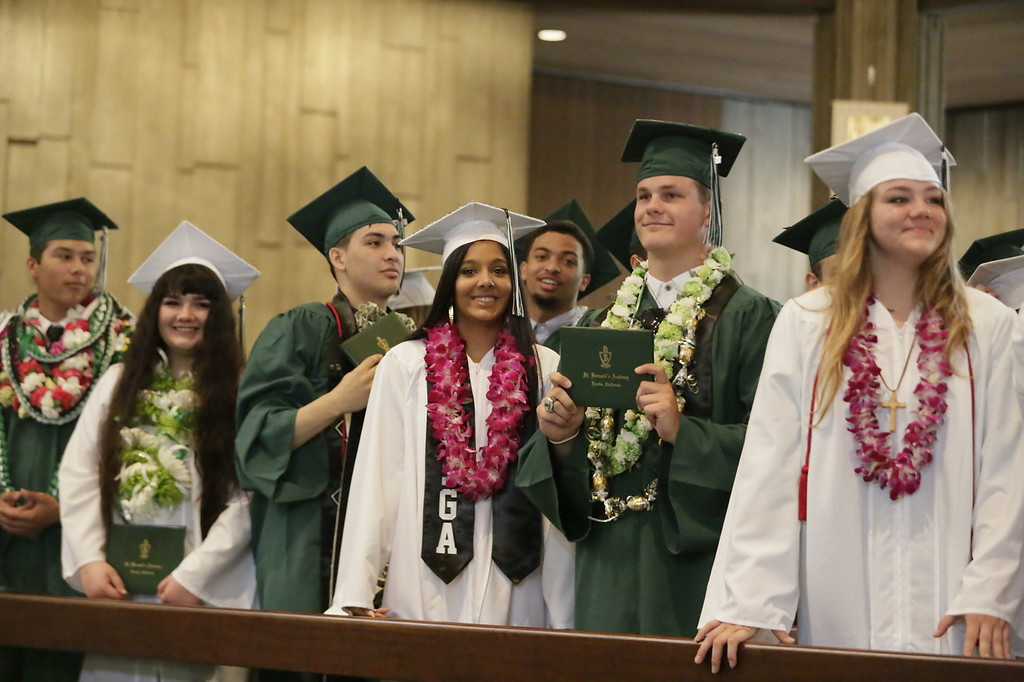 . Shaun Walker � The Times-Standard  St. Bernard\'s Academy seniors celebrate getting their diplomas at the Eureka school\'s graduation ceremony on Saturday. The private Catholic school graduated 48 students.