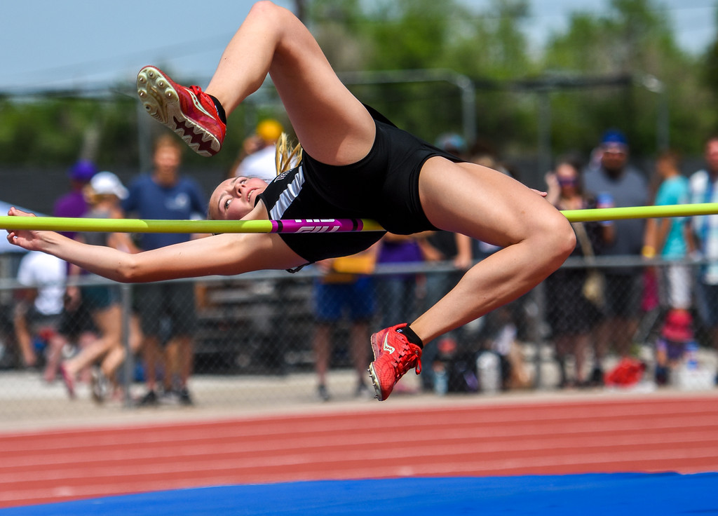 . Berthoud\'s Sophia Visger attempts to clear the bar during the high jump at the 2018 state track and field meet Thursday May 17, 2018 at Jeffco Stadium in Lakewood. (Cris Tiller / Loveland Reporter-Herald)