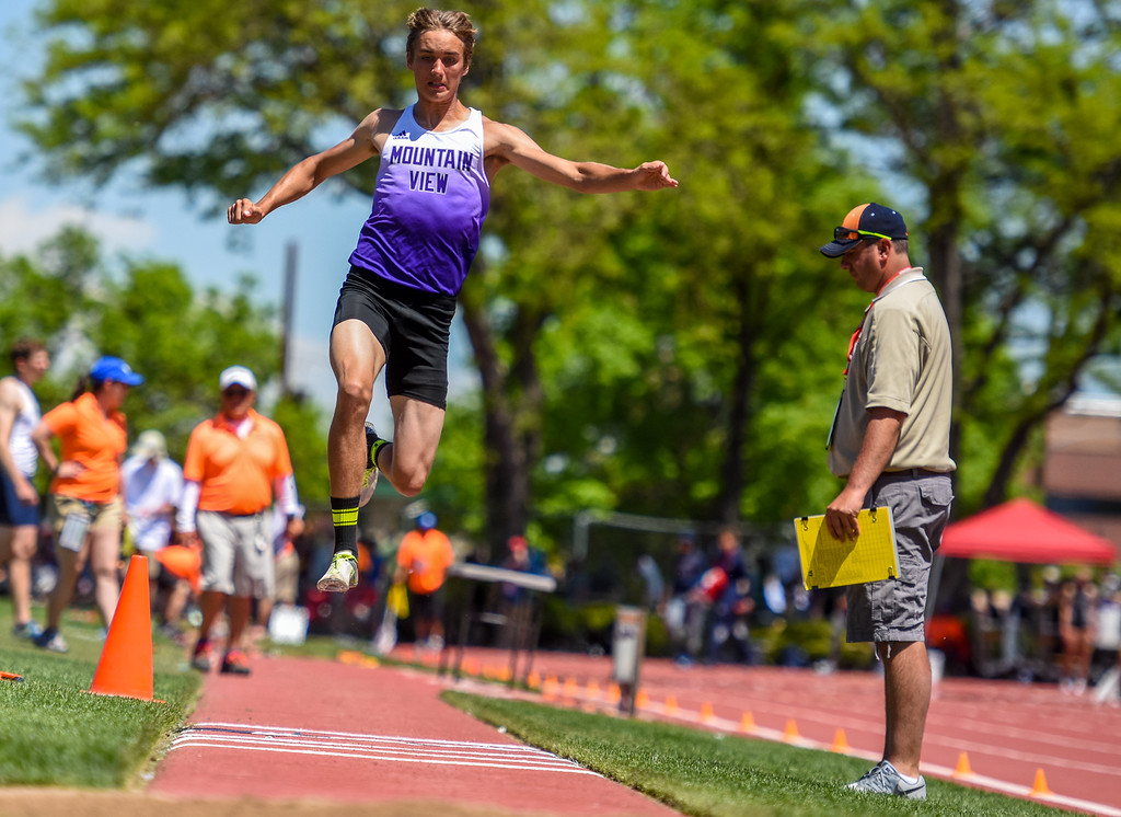 . Mountain View\'s Haden Marr flies through the air during the triple jump at the 2018 state track and field meet Thursday May 17, 2018 at Jeffco Stadium in Lakewood. (Cris Tiller / Loveland Reporter-Herald)