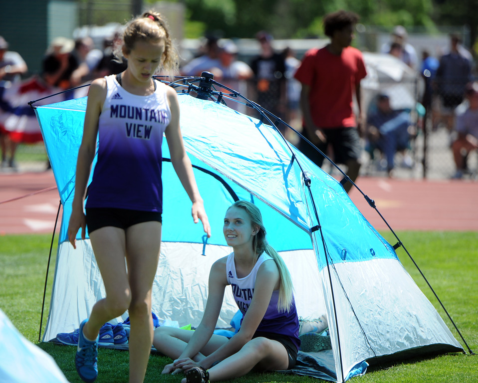 . Mountain View\'s Chloe Miller, right, and Laurene Powell wait to compete in high jump at the 2018 state track and field meet on Thursday, May 17, 2018 at Jeffco Stadium in Lakewood. (Sean Star/Loveland Reporter-Herald)