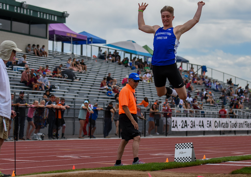 . Resurrection Christian\'s Tanner Applebee takes to the air during the 2A long jump competition at the 2018 state track and field meet Thursday May 17, 2018 at Jeffco Stadium in Lakewood. (Cris Tiller / Loveland Reporter-Herald)