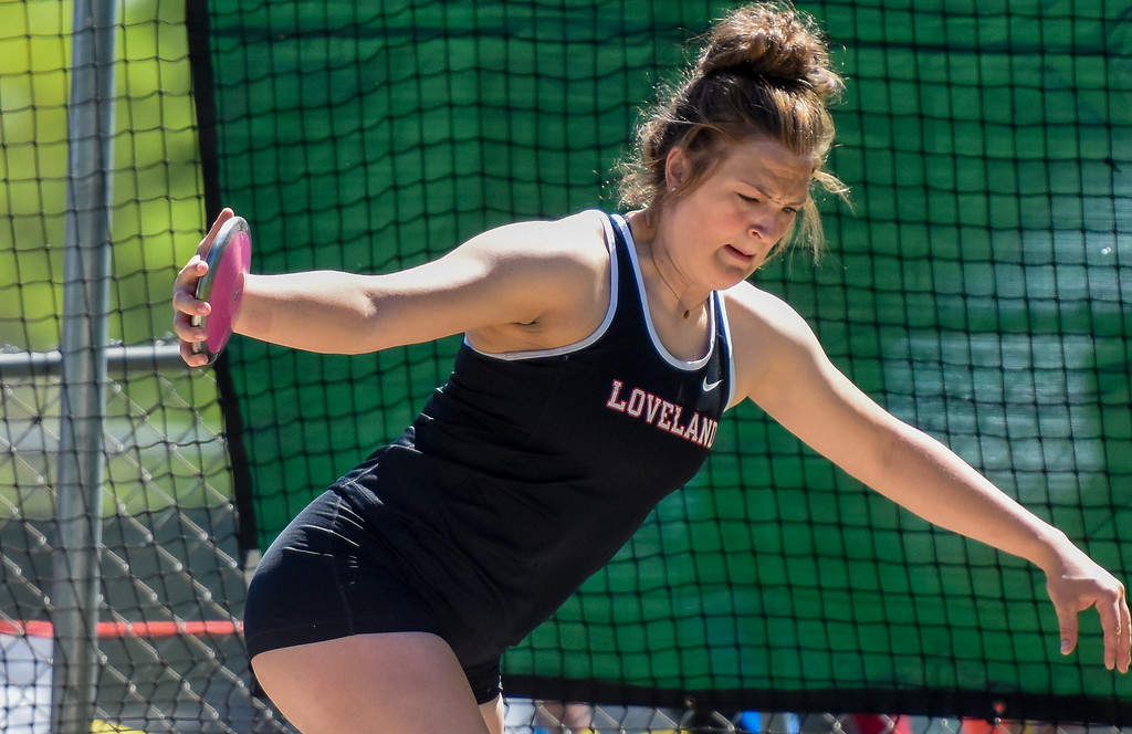 . Loveland\'s Moira Dillow throws the discus at the 2018 state track and field meet Thursday May 17, 2018 at Jeffco Stadium in Lakewood. (Cris Tiller / Loveland Reporter-Herald)