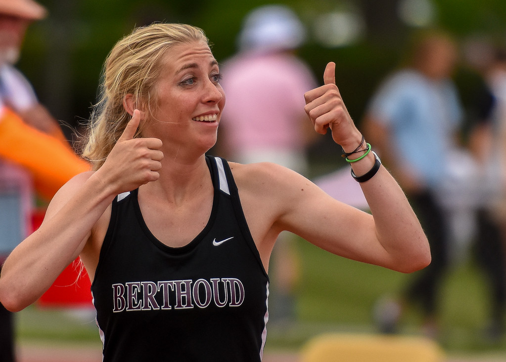 . Berthoud\'s Cailey Archer gives a pair of thumbs up to her coach after clearing the bar during the high jump competition at the 2018 state track and field meet Thursday May 17, 2018 at Jeffco Stadium in Lakewood. (Cris Tiller / Loveland Reporter-Herald)