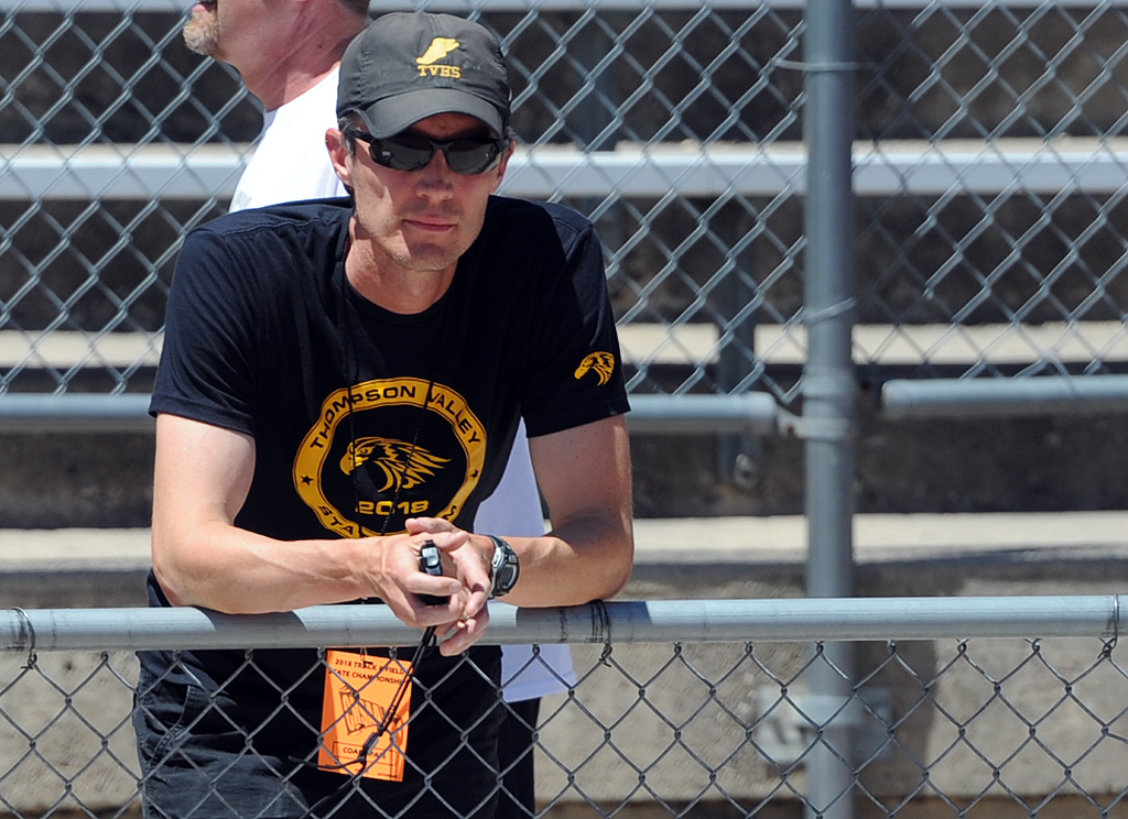 . Thompson Valley coach Matt Norton watches the girls 4x800 relay at the 2018 state track and field meet on Thursday, May 17, 2018 at Jeffco Stadium in Lakewood. (Sean Star/Loveland Reporter-Herald)