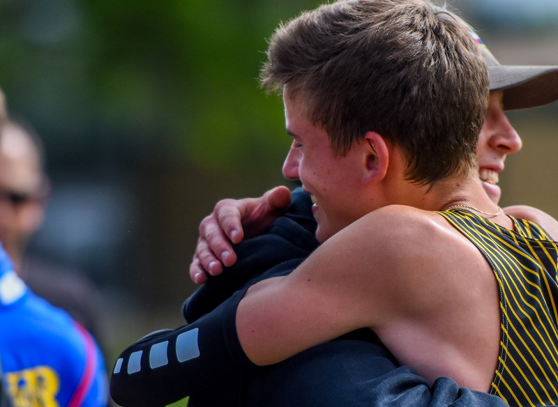 Thompson Valley's Dylan Schubert hugs one of his coaches after placing third in the 4A 3,200-meter run at the 2018 state track and field meet Friday May 18, 2018 at Jeffco Stadium in Lakewood. (Cris Tiller / Loveland Reporter-Herald)
