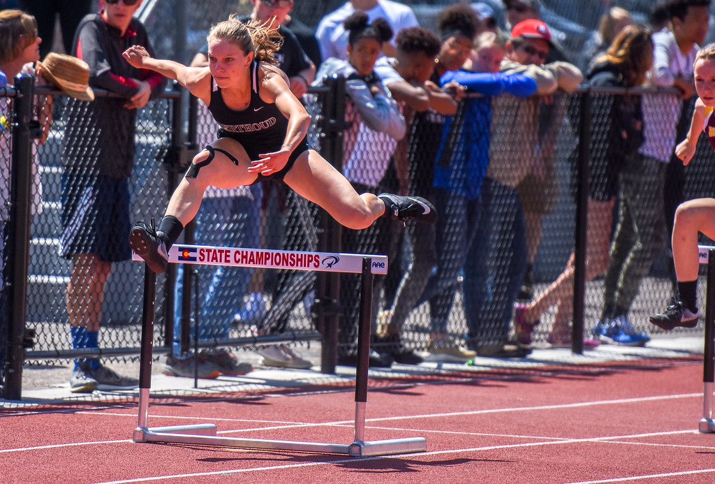 . Berthoud\'s Samantha Mulder leaps a hurdle during the 300-meter hurdles at the 2018 state track and field meet Friday May 18, 2018 at Jeffco Stadium in Lakewood. (Cris Tiller / Loveland Reporter-Herald)
